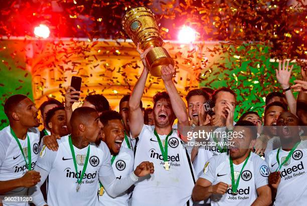 TOPSHOT Frankfurt's players celebrate with the trophy after the German Cup DFB Pokal final football match FC Bayern Munich vs Eintracht Frankfurt at...