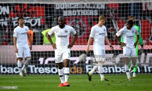 Frankfurt's players react after scoring an own goal during the German first division Bundesliga football match Bayer Leverkusen vs Eintracht...