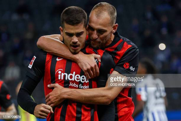 Frankfurt's Portuguese forward Andre Silva celebrates scoring the opening goal from the penalty spot with his teammate Frankfurt's Dutch forward Bas...