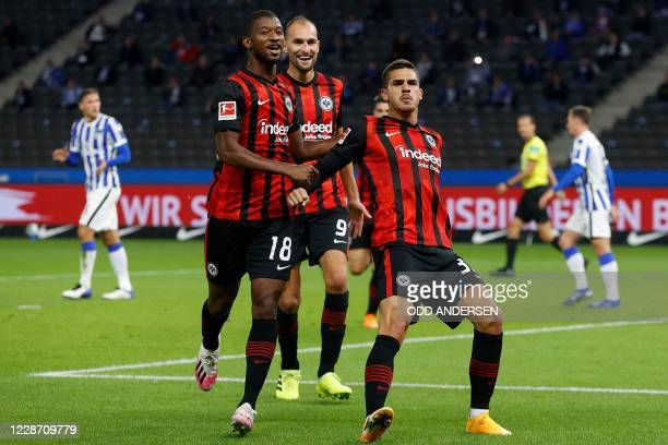 Frankfurt's Portuguese forward Andre Silva celebrates scoring the opening goal from the penalty spot during the German first division Bundesliga...