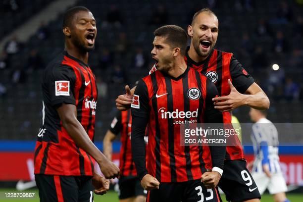 Frankfurt's Portuguese forward Andre Silva celebrates scoring the opening goal from the penalty spot with his teammates Frankfurt's Malian defender...