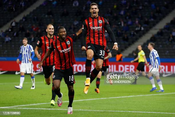 Frankfurt's Portuguese forward Andre Silva celebrates scoring the opening goal from the penalty spot with his teammates during the German first...