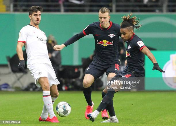 Frankfurt's Portuguese forward Andre Silva , Leipzig's German defender Lukas Klostermann and Leipzig's French midfielder Christopher Nkunku vie for...