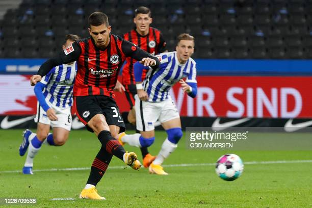 Frankfurt's Portuguese forward Andre Silva scores the opening goal from the penalty spot during the German first division Bundesliga football match...