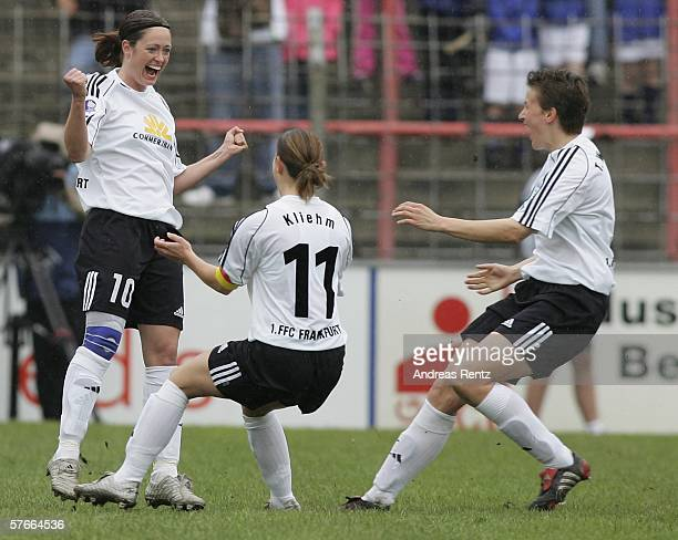 Frankfurts Renate Lingor celebrates whr first goal with Katrin Kliehm and Tina Wunderlich during the Women's UEFA Cup Final first leg match between...