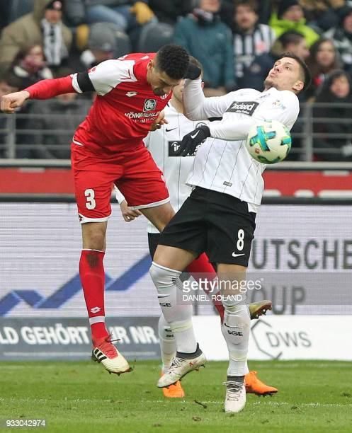 Frankfurt's Serbian forward Luka Jovic and Mainz' Nigerian defender Leon Balogun vie for the ball during the German First division Bundesliga...
