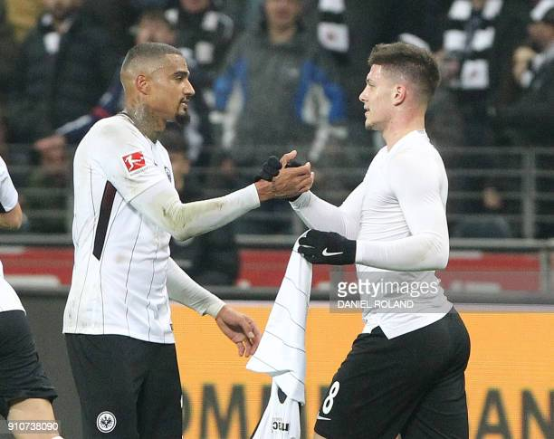 Frankfurt's Serbian forward Luka Jovic celebrates scoring the 20 goal with Frankfurt's Ghanaian midfielder KevinPrince Boateng during the German...