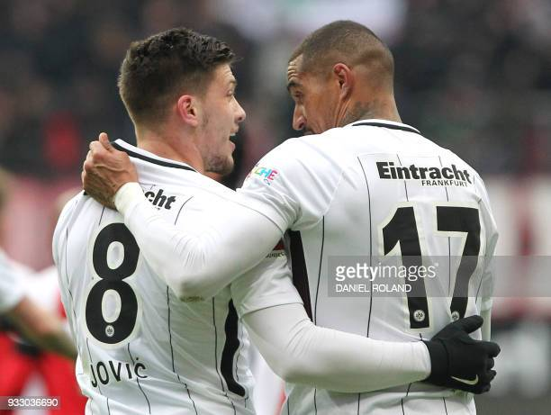 Frankfurt's Serbian forward Luka Jovic celebrates scoring the 20 with Frankfurt's Ghanaian midfielder KevinPrince Boateng during the German First...