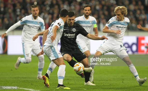 Frankfurt's Serbian forward Luka Jovic vies for the ball with Lazio's Brazilian defender Luiz Felipe and Lazio's Serbian defender Dusan Basta during...