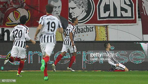 Frankfurt's Serbian midfielder Mijat Gacinovic celebrates after scoring the opening goal with his teammates during the German first division...