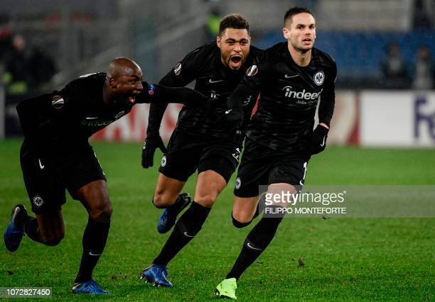 Frankfurt's Serbian midfielder Mijat Gacinovic followed by Frankfurt's French defender Simon Falette celebrates after scoring an equalizer during the...