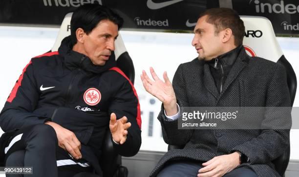 Frankfurt's sport director Bruno Huebner and Oliver Frankenbach finance board member of Eintracht Frankfurt Fußball AG talk before the match...