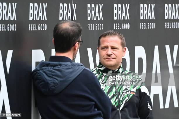 Frankfurt's sporting director Fredi Bobic speaks to Moenchengladbach's sporting director Max Eberl prior to the German first division Bundesliga...