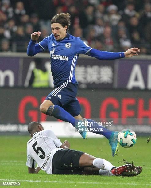 Frankfurt's Swiss midfielder Gelson Fernandes and Schalke's French midfielder Benjamin Stambouli vie for the ball during the German first division...