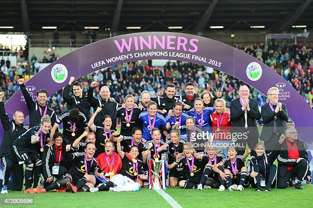 Frankfurt's team poses with the trophy after their 21 win in the UEFA Champions League women football match final Paris SaintGermain vs 1 FFC...