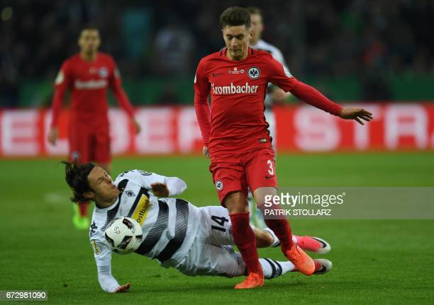 Frankfurt's Uruguayan defender Guillermo Varela and Moenchengladbach's midfielder Marvin Schulz vie for the ball during the German Cup DFB Pokal...