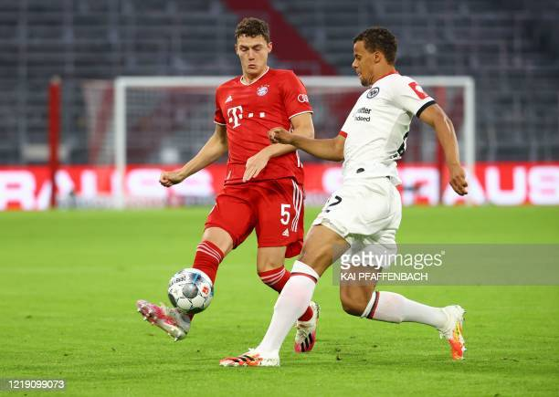 Frankfurt's US defender Timothy Chandler and Bayern Munich's French defender Benjamin Pavard vie for the ball during the German Cup semi-final...