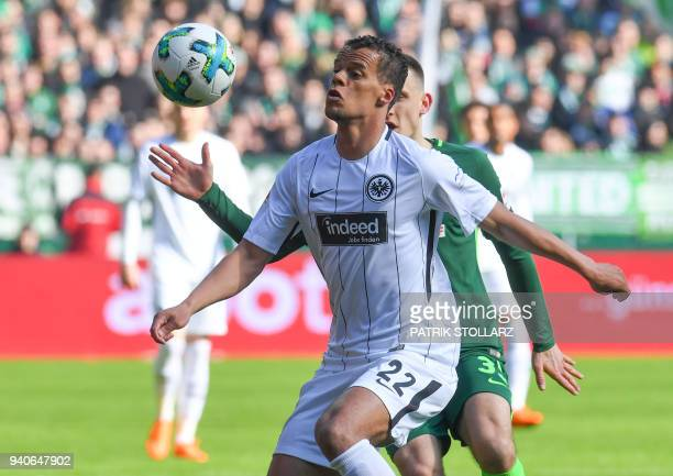 Frankfurt's US defender Timothy Chandler and Bremen's German midfielder Maximilian Eggestein vie for the ball during the German first division...