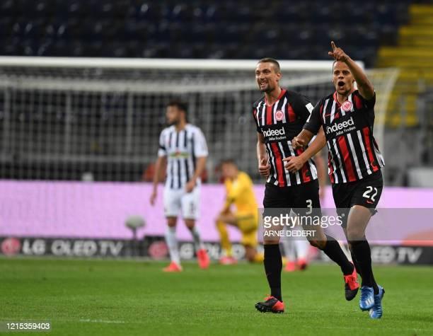 Frankfurt's US defender Timothy Chandler celebrates scoring with his team-mate Frankfurt's Austrian midfielder Stefan Ilsanker during the German...