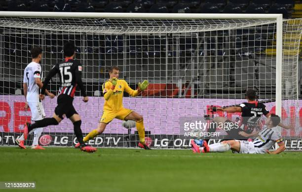 Frankfurt's US defender Timothy Chandler scores past Freiburg's German goalkeeper Alexander Schwolow during the German first division Bundesliga...