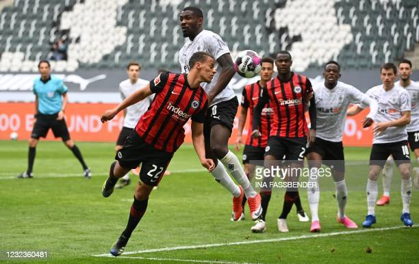 Frankfurt's US midfielder Timothy Chandler and Moenchengladbach's French forward Marcus Thuram vie for the ball during the German first division...