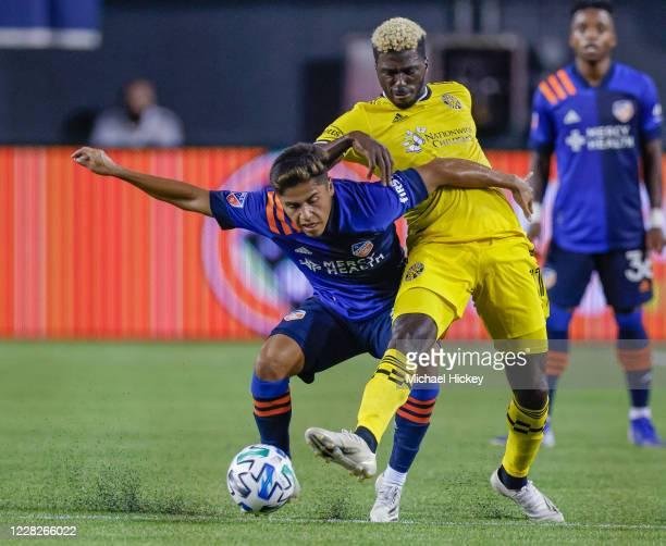 Frankie Amaya of FC Cincinnati battles for the ball against Gyasi Zerdes of Columbus Crew at Nippert Stadium on August 29, 2020 in Cincinnati, Ohio.