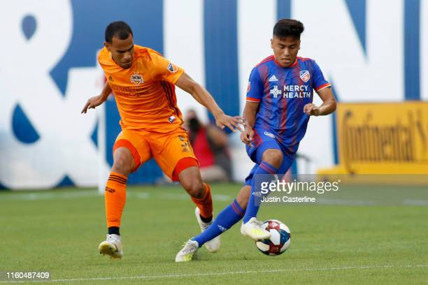 Frankie Amaya of FC Cincinnati controls the ball against Juan Cabezas of Houston Dynamo at Nippert Stadium on July 06 2019 in Cincinnati Ohio