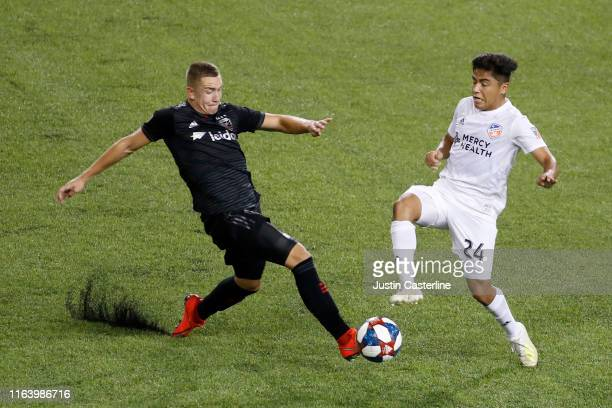 Frankie Amaya of the FC Cincinnati and Russell Canouse fight for the ball at Nippert Stadium on July 18, 2019 in Cincinnati, Ohio.