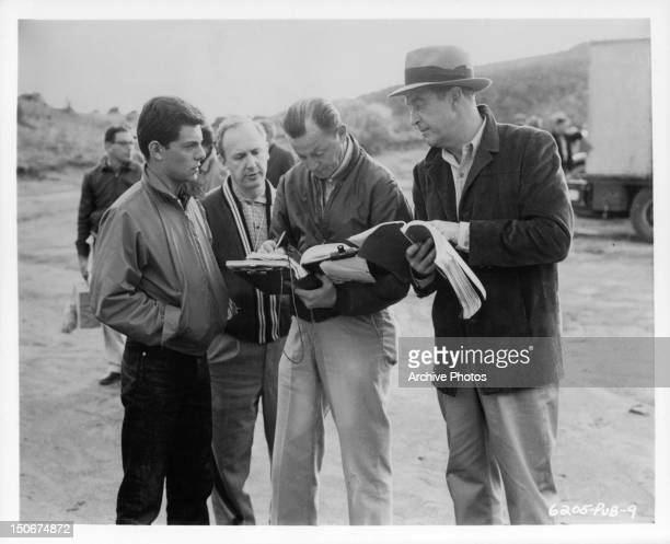 Frankie Avalon and Ray Milland going over scripts in between scenes from the film 'Panic In Year Zero' 1962