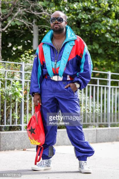 Frankie B. Is seen wearing purple vintage jumpsuit, diamond Rolex watch, and white Christian Dior sneakers during New York Fashion Week on September...