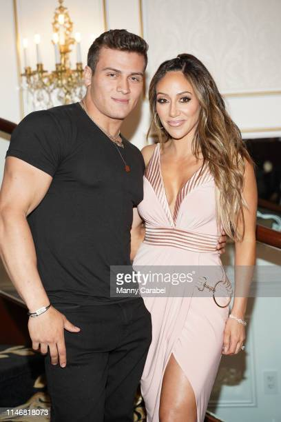 Frankie Catania and Melissa Gorga attend the Envy By Melissa Gorga Fashion Show on May 03, 2019 in Hawthorne, New Jersey.
