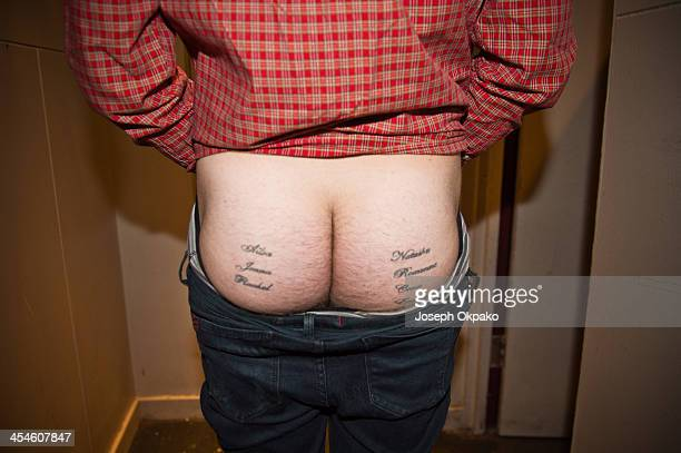 Frankie Cocozza of The Telescreen shows off his tattoos of girls names at The Garage on December 9 2013 in London United Kingdom