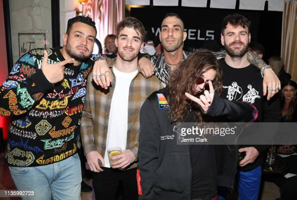 Frankie Delgado poses with Drew Taggart and Alex Pall of The Chainsmokers and guests at the Wheels LA Launch at Sunset Tower on March 14 2019 in Los...