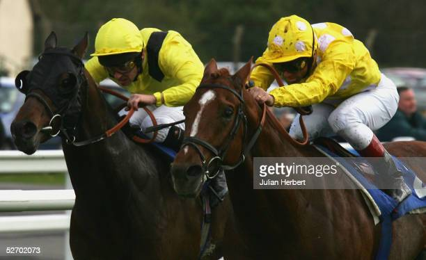Frankie Dettori and Andronikos get the better of the Ted Durcan ridden Yajbill to land The Hesbonds Stud Pavilion Stakes Race run at Lingfield Park...