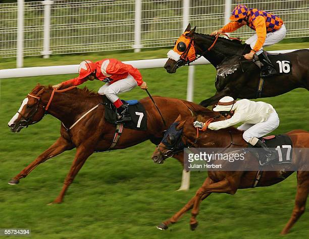 Frankie Dettori and Beaver Patrol lead the Eddie Ahern ridden Coconut Squeak and the Alan Munro partnered Swinbrook home to land The Helen Rix Stakes...