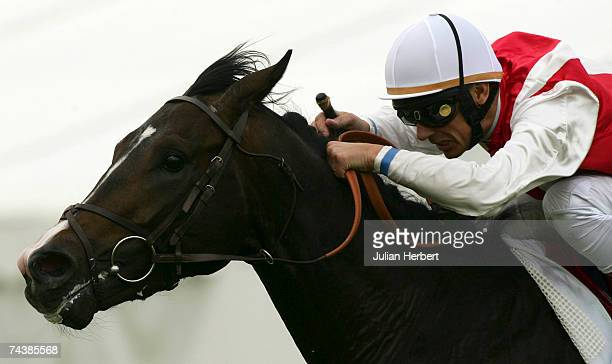 Frankie Dettori and Lawman land The Prix Du Jockey Club Mitsubishi Motors run at Chantilly Racecourse on June 3 in Chantilly France