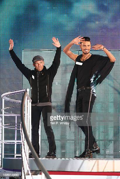 Frankie Dettori and Rylan Clark enter the Celebrity Big Brother House at Elstree Studios on January 3 2013 in Borehamwood England