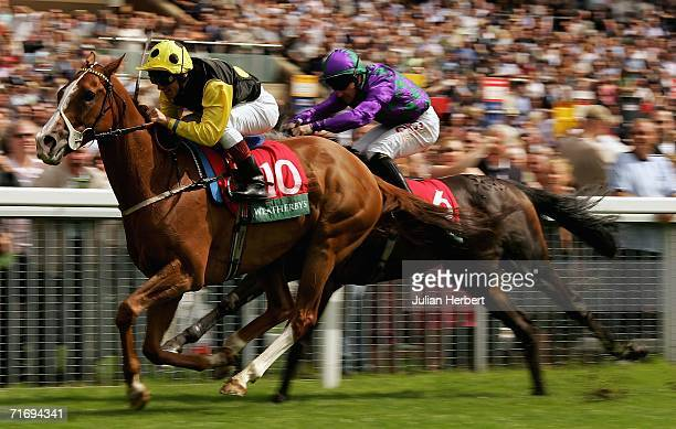 Frankie Dettori and Sergeant Cecil pass the Neil Callan ridden Franklins Gardens to land The Weatherbys Insurance Lonsdale Cup Race run at York...