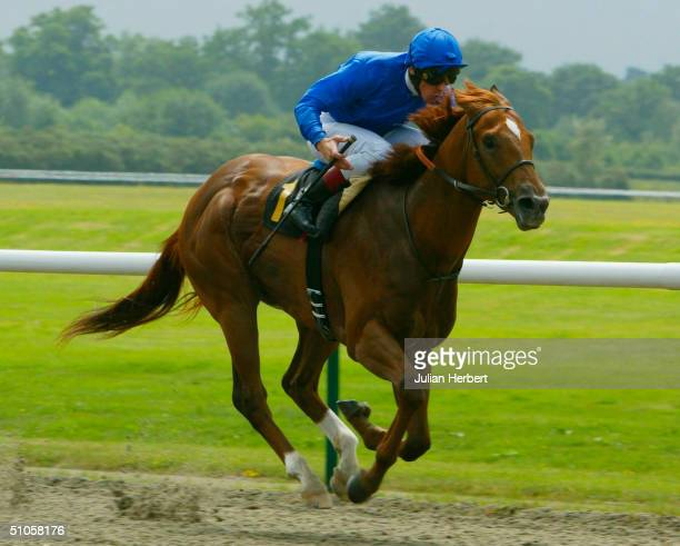 Frankie Dettori and The Godolphin trained Afrashad score an easy victory in The EBF Maiden Stakes Race run at Lingfield Park Racecourse on July 14...