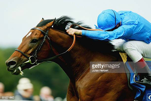 Frankie Dettori and the Godolphin trained Refuse To Bend come out of the pack to land The CoralEclipse Stakes Race run at Sandown Racecourse on July...
