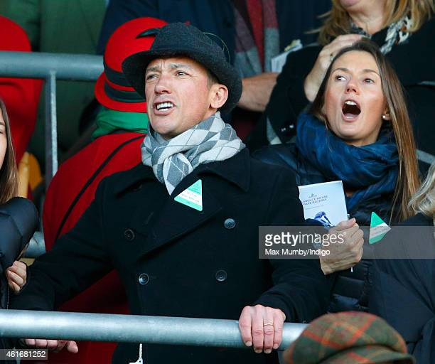 Frankie Dettori and wife Catherine Dettori cheer as they watch Dodging Bullets run to victory in the Sodexo Clarence House Steeple Chase during the...