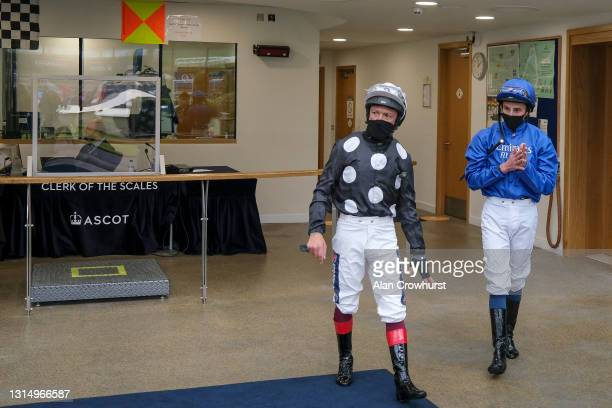 Frankie Dettori and William Buick leave the weighing room at Ascot Racecourse on April 28, 2021 in Ascot, England. Sporting venues around the UK...