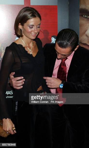 Frankie Dettori arrives with his wife Catherine for the premiere of Mean Machine at the Odeon Kensington The film produced by Matthew Vaughan is a...
