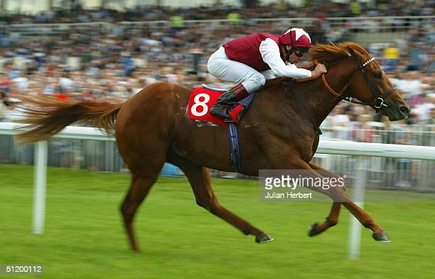 Frankie Dettori brings Windsor Knot home to land The Iveco Daily Solario Stakes Race run at Sandown Racecourse on August 21 2004 at Sandown England
