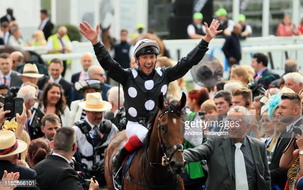 Frankie Dettori celebrates after riding Anapurna to victory in the Investec Oaks at Epsom Racecourse on May 31, 2019 in Epsom, England.