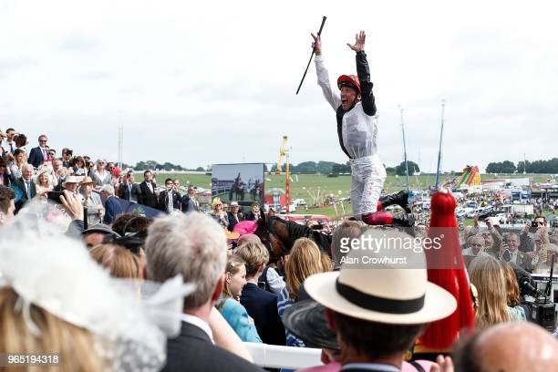 Frankie Dettori celebrates after riding Cracksman to win The Investec Coronation Cup during the Investec Ladies Day at Epsom Downs Racecourse on June...