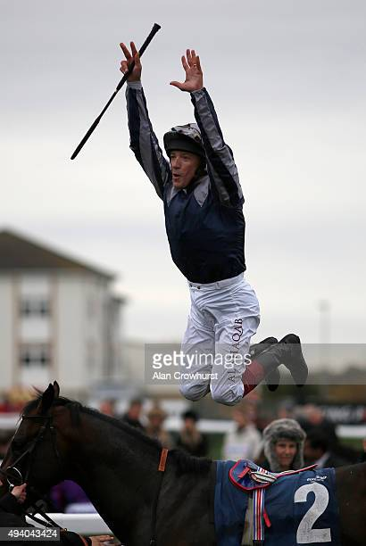 Frankie Dettori celebrates after riding Dhahmaan to win The Scott Dobson memorial Doncaster Stakes at Doncaster racecourse on October 24 2015 in...
