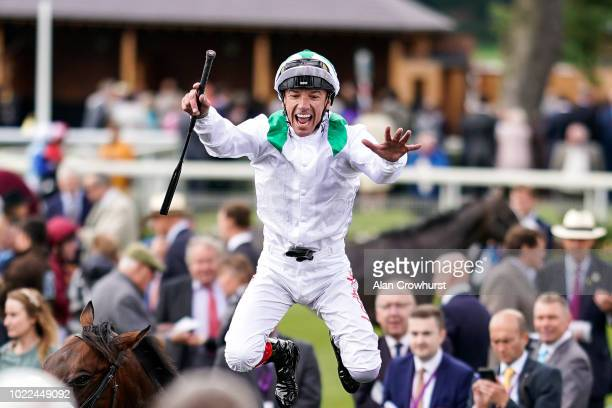 Frankie Dettori celebrates after riding Emaraaty Ana to win The Al Basti Equiworld Gimcrack Stakes at York Racecourse on August 24, 2018 in York,...