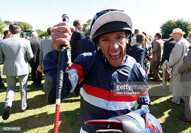 Frankie Dettori celebrates after riding Magical Memory to win The Qatar Stewards' Cup at Goodwood racecourse on August 01 2015 in Chichester England