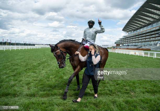 Frankie Dettori celebrates after riding Palace Pier to win The St James's Palace Stakes during Day Five of Royal Ascot 2020 at Ascot Racecourse on...